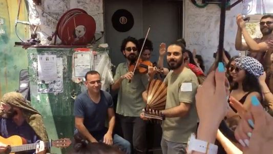 Watch Palestinians reclaim public spaces with joyous music in the streets